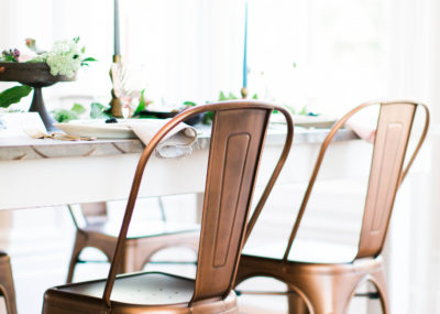 Durham Copper Chairs arranged at table