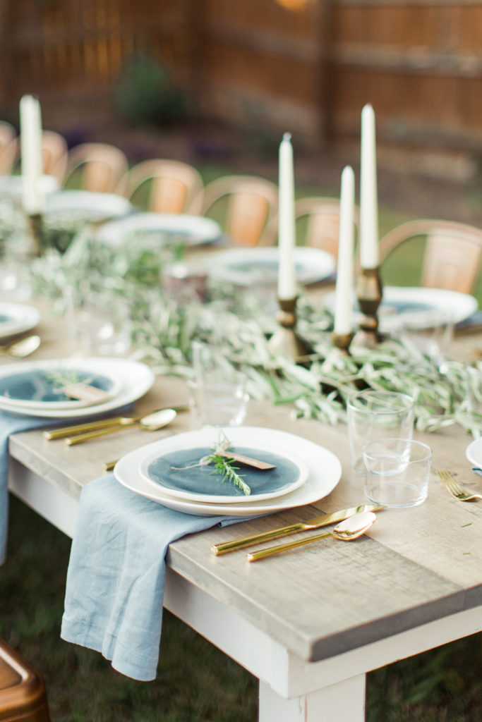 Cottage Luxe Event Rentals Raleigh Signature Farm Tables with dishes
